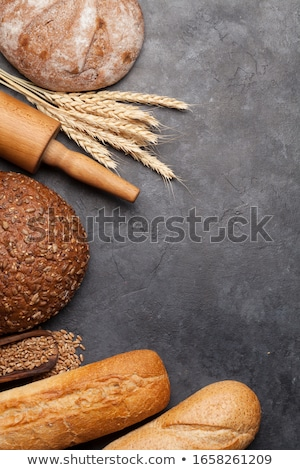 Various bread with wheat, flour and cooking utensils Stock photo © karandaev