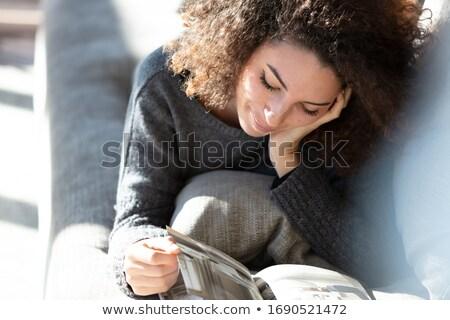 красивая женщина Lounge чтение журнала довольно Сток-фото © Giulio_Fornasar