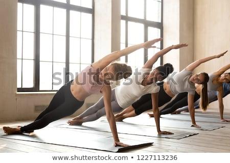 Woman doing yoga asana Vasisthasana Stock photo © dmitry_rukhlenko