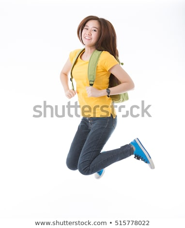 Chinese school girl jumping in the air. Stock photo © cardmaverick2