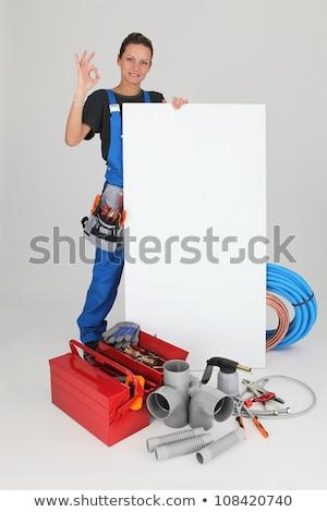 női · vízvezetékszerelő · guggol · felszerlés · tájkép · kék - stock fotó © photography33