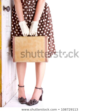 female legs with hands holding vintage case stock photo © vkraskouski
