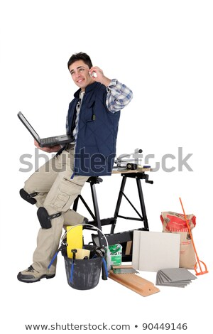 Tiler with a laptop and cellphone Stock photo © photography33