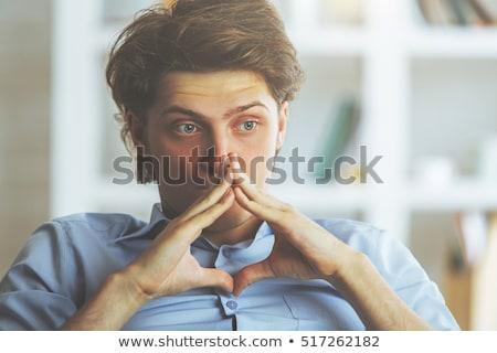 Portré fiatalember néz aggódó kéz narancs Stock fotó © photography33