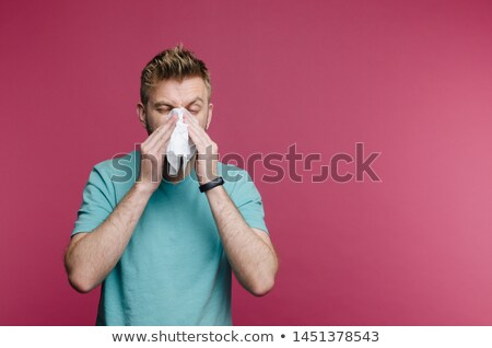 Young guy suffering from cold Stock photo © stockyimages