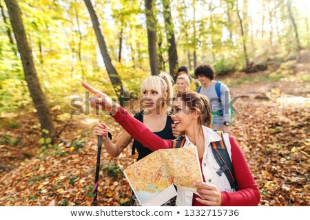 Backpacker pointing the way Stock photo © photography33