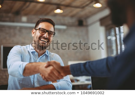 Smiling business people closing a deal Stock photo © wavebreak_media