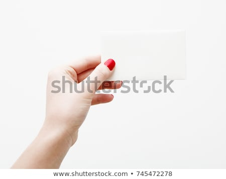 womans hand holding a red business card stock photo © inxti
