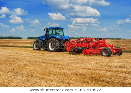 red and blue tractor stock photo © tepic