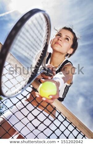 Beautiful young girl rests on a tennis net Stock photo © BrunoWeltmann