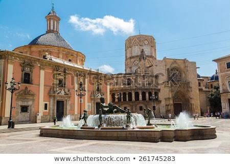 Valencia Plaza de la Virgen Neptuno foutain and Cathedral Stock photo © lunamarina
