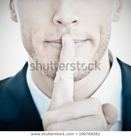 silenzio · gesto · bello · giovane · dito · labbra - foto d'archivio © stockyimages