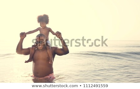 Son and mom chill on the beach Stock photo © punsayaporn