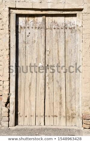 primitive ladder and door in an old wooden barn Stock photo © PixelsAway