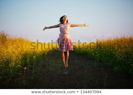 happy girl jumping at sunset Stock photo © adrenalina