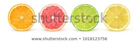Stok fotoğraf: Narenciye · olgun · limon · portakal · yeşil · yaprak · beyaz
