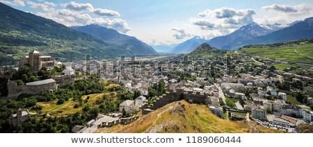 Stad Zwitserland heuvel huis wolken Stockfoto © romitasromala