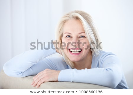 Out of Focus Image of a Woman with Blue Cloth Stock photo © courtyardpix