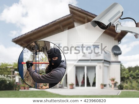 Burglar Using Crowbar To Open Glass Door Stock photo © AndreyPopov