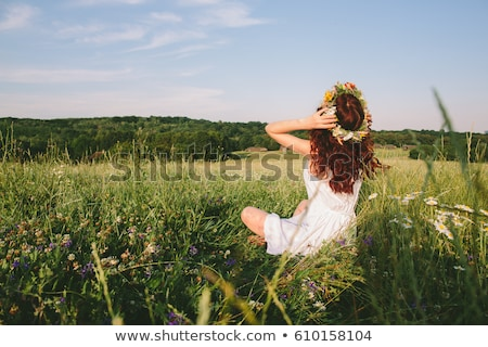 Happy redhead woman with wreath from flowers on head Stock photo © deandrobot