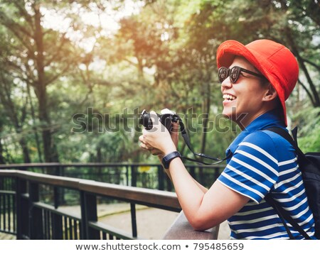Hipster female photographer exploring spring nature landscapes a Stock photo © stevanovicigor