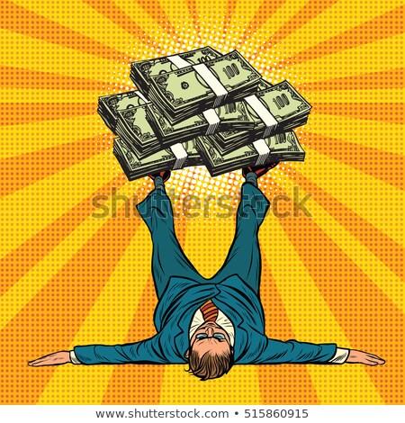 Businessman athlete holds a lot of money on legs Stock photo © studiostoks