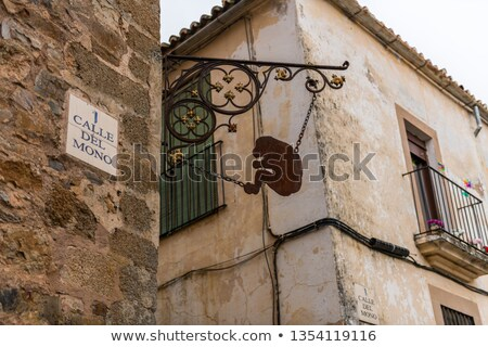 Caceres Calle del mono Monkey street Spain Stock photo © lunamarina