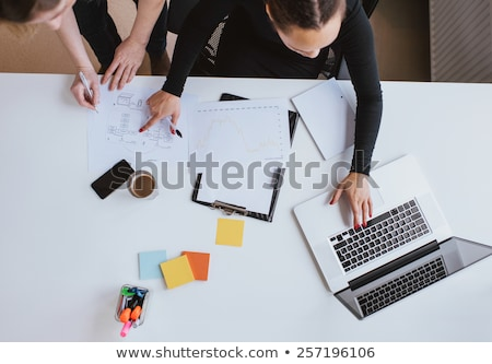 cropped image of business woman with documents stock photo © deandrobot