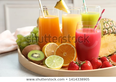 Glasses of fruit juice drinks Stock photo © Digifoodstock