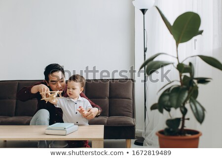 father playing toys with his little cute son indoors stock photo © deandrobot