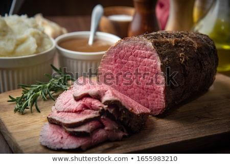 Crudo carne de vacuno rebanadas tabla de cortar alimentos Foto stock © Digifoodstock