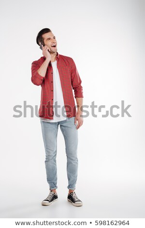 Vertical image of man talking on smartphone Stock photo © deandrobot
