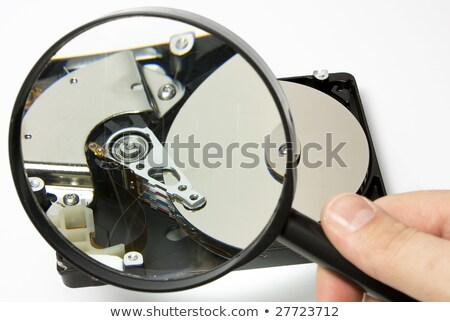 hard disk and magnifier close-up Stock photo © OleksandrO
