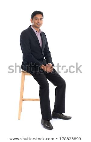 Full body Asian businessman seated on chair Stock photo © szefei
