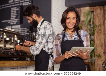 Male waiter and female waitress with digital tablet Stock photo © wavebreak_media