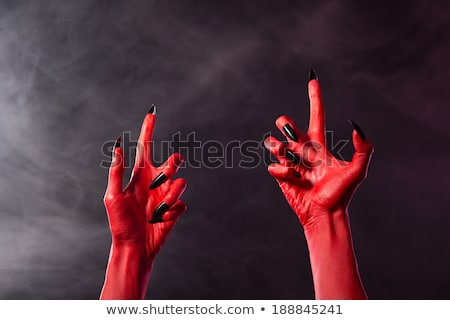Red devil hand with black glossy nails   Stock photo © Elisanth