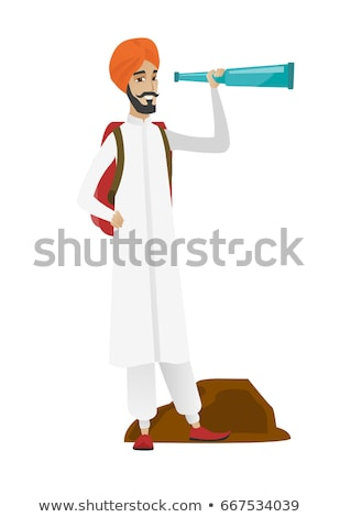 Young hindu traveler with spyglass. Stock photo © RAStudio