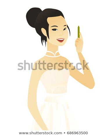 Young asian smiling fiancee with pen. Stock photo © RAStudio