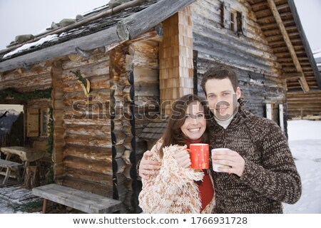 Young couple in front of chalet Stock photo © IS2