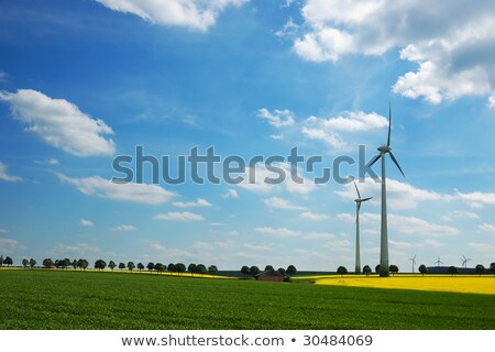 Wind turbines against stormy sky Stock photo © IS2