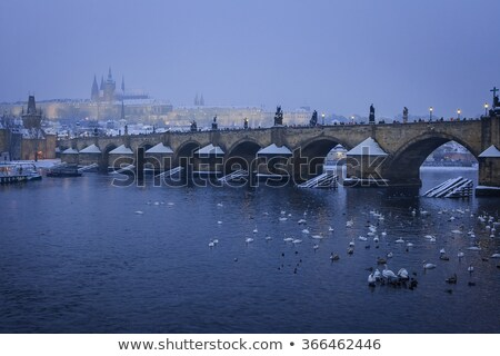 lavka and prague castle with charles bridge in winter prague c stock photo © phbcz