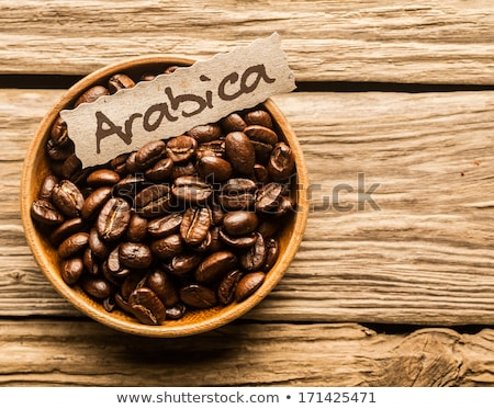 Bowls of arabica and robusta coffee beans Stock photo © Alex9500