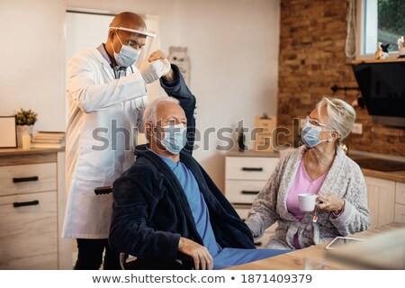 Female Doctor Helping Senior Adult Woman With Arm Exercises Stock photo © feverpitch