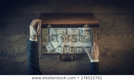 successful businessman with briefcase full of money in hands arab european vector isolated illust stock photo © pikepicture