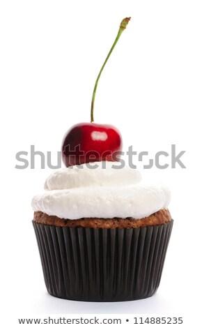 Chocolate cupcake with cherry whipped cream  stock photo © TasiPas