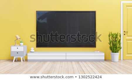 Tv on yellow tv cabinet Stock photo © magraphics