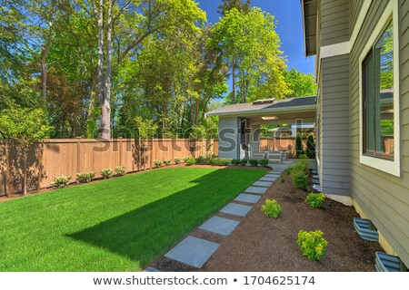 large fenced back yard with a garage stock photo © iriana88w