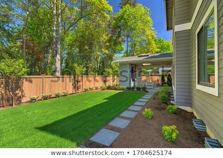 Large fenced back yard with a garage. Stock photo © iriana88w
