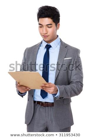 homem · de · negócios · leitura · clipboard · escritório · homem · educação - foto stock © Minervastock