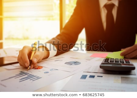 Hand holding tablet and checking finantial report concept Stock photo © ra2studio